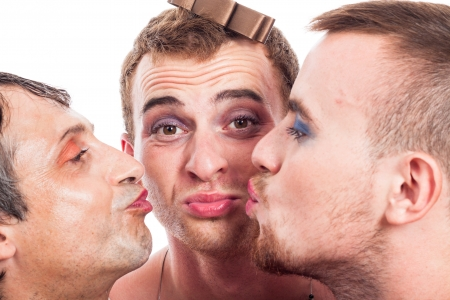 travesty: Close up of three cute transvestites kissing, isolated on white background