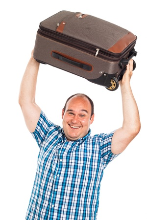 Laughing passenger man lifting up his luggage, isolated on white background photo
