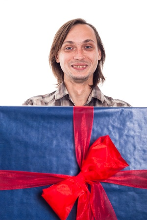 weirdo: Funny man with big blue gift box, isolated on white background