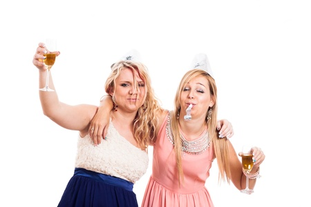 drunk party: Two drunk girls celebrate with alcohol, isolated on white background