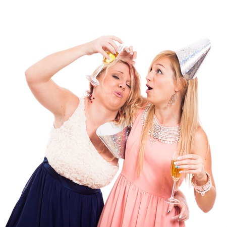 Two Funny drunken girls celebrate with alcohol, isolated on white background photo