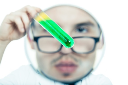 Scientist face through magnifying glass exploring test tube, isolated on white background photo