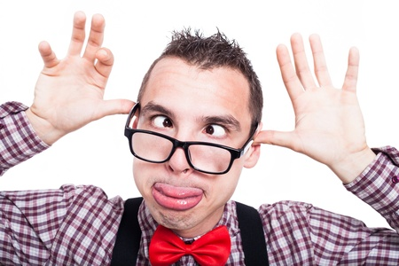 Silly cross-eyed nerd man making funny face, isolated on white background Stockfoto