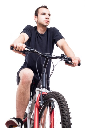 Young man on bicycle, isolated on white background photo