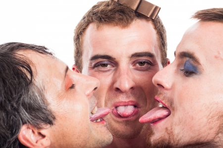 Close up of three bizarre transvestites sticking out tongue, isolated on white background