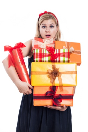 Surprised woman holding many gift boxes, isolated on white background  photo