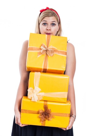 Surprised woman carrying yellow gift boxes, isolated on white background  photo
