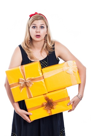 Shocked woman carrying yellow gift boxes, isolated on white background  photo