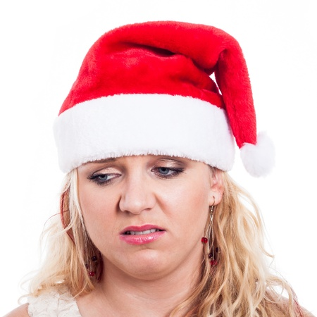disappoint: Disappointed woman in Christmas hat, isolated on white background.
