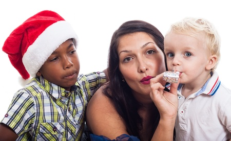 Woman with children celebrate Christmas, isolated on white background. photo