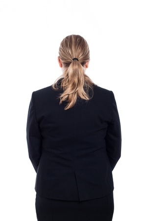 Rear view of business woman in suit, isolated on white background. photo