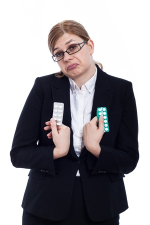 indecisive: Indecisive business woman holding pills, isolated on white background.