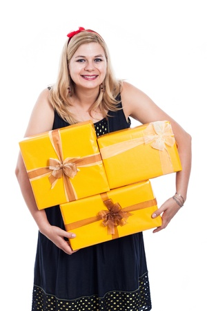 Funny woman carrying yellow gift boxes, isolated on white background. photo