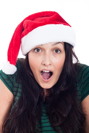 Surprised woman in Christmas hat, isolated on white background  photo