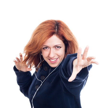 Ecstatic woman with earphones enjoying music, isolated on white background  photo