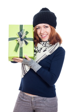Ecstatic happy winter woman holding present, isolated on white background  photo