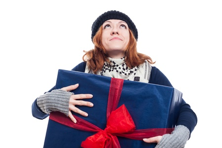 Thankful winter woman holding big present and looking up, isolated on white background  photo