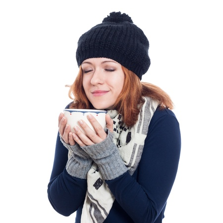 Happy woman in winter clothes enjoying hot drink, isolated on white background  photo