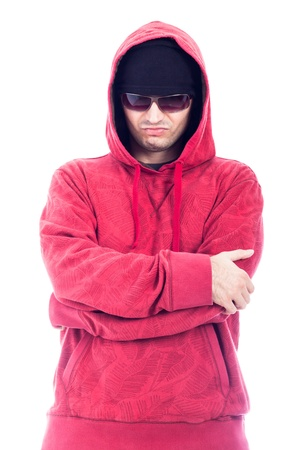 Self-confident hip-hop style man in red hoodie and sunglasses, isolated on white background  photo