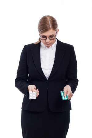 painkillers: Business woman holding pills, isolated on white background. Stock Photo