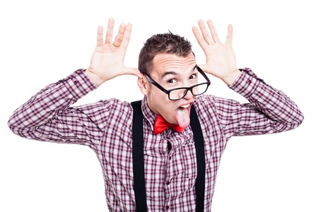 Eccentric nerd man making funny faces and sticking out tongue, isolated on white background photo