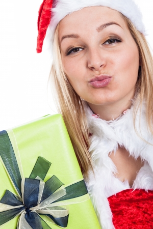 Closeup of thankful Christmas woman sending kiss. photo