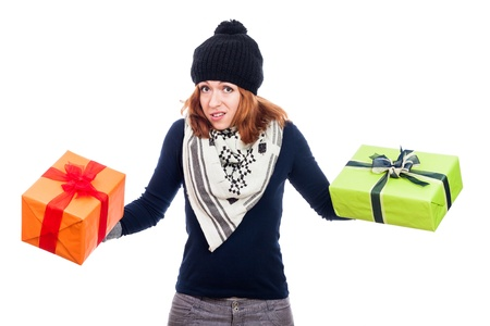 Disappointed winter woman holding two presents, isolated on white background. photo