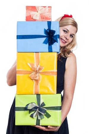 Happy woman holding many colorful presents, isolated on white background. photo