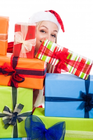 Christmas woman hiding behind many presents, isolated on white background. photo