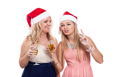 Two Christmas women celebrate with alcohol, isolated on white background photo