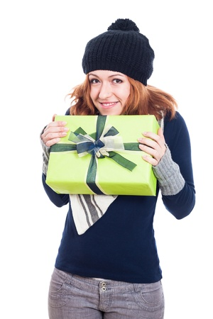Happy winter woman holding present, isolated on white background. photo