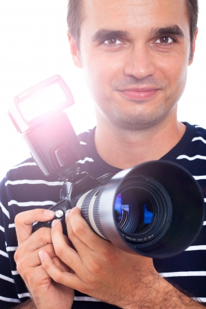 Portrait of photographer holding professional camera. photo