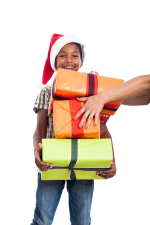 Happy child getting many Christmas presents, isolated on white background. Stockfoto
