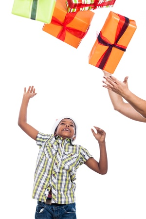 Exited child catching Christmas presents, isolated on white background. photo