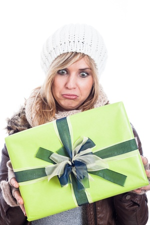 Disappointed woman holding present, isolated on white background. photo