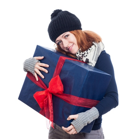 Cute winter woman holding big present, isolated on white background. photo