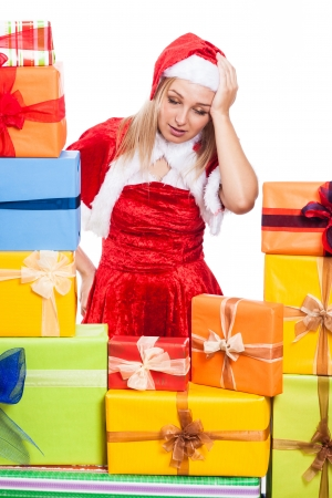 tiring: Stressed Christmas woman with many presents, isolated on white background.
