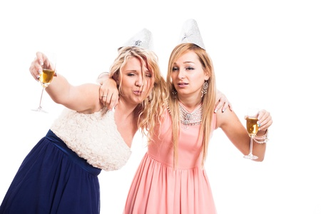 Two drunk women celebrate with alcohol, isolated on white background photo