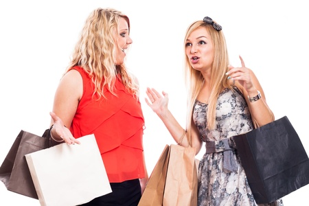 Two excited blond girls talking and shopping, isolated on white background photo