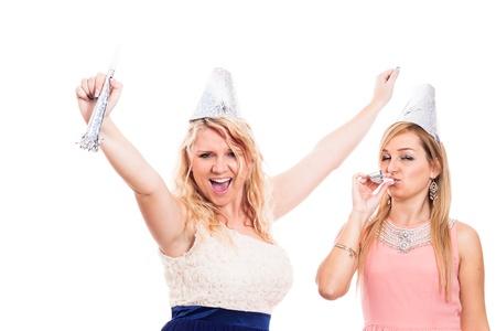 Two young ecstatic women celebrating, isolated on white background photo