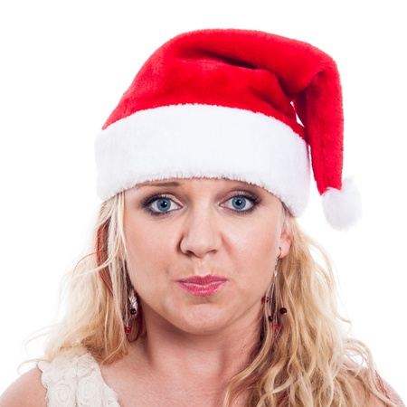 Surprised woman in Christmas hat, isolated on white background. photo