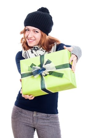 Happy woman in winter hat giving present, isolated on white background. photo