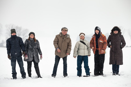 Group of happy people enjoying winter in snow. photo