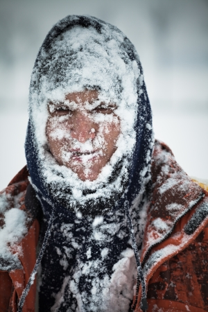 Man covered by snow in snowstorm. Stock Photo