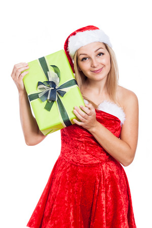 Smiling Christmas woman holding present, isolated on white background. photo