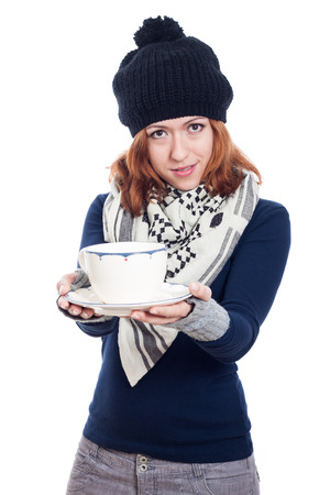 Woman in winter hat holding mug of tea or coffee, isolated on white background. photo