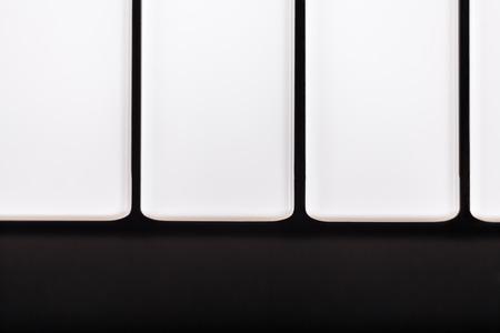 Macro of white piano keys. photo