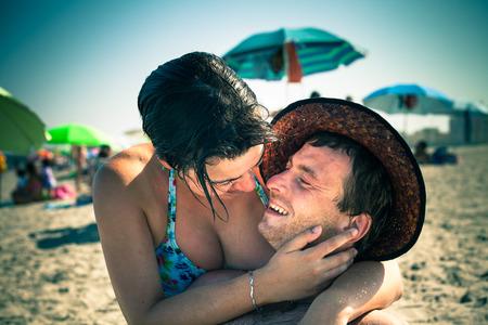 Happy lovers enjoying sunny day on the beach. photo