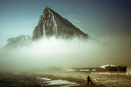 The Rock of Gibraltar. Abstract creative photo of Gibraltar Rock in foggy morning. photo
