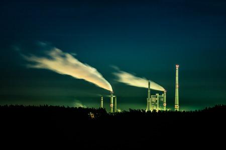 Smoking factory at night photo